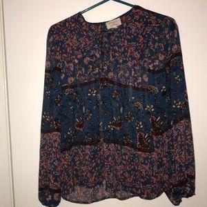 Blue patterned blouse